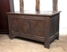 A late 17th century oak coffer, the triple panelled front carved with lozenges, on block feet, 105cm