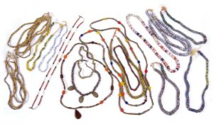 A quantity of African trade bead necklaces, mainly yellow including Venetian millefiori plus