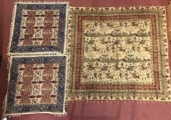 A pair of Isfahan table covers with foliate decoration, 53 x 52cm and a larger table cover decorated