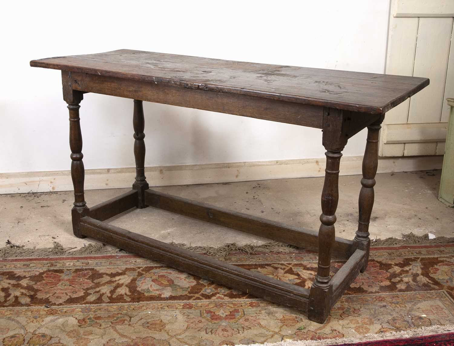 An 18th century oak rectangular side table, on baluster turned legs united by stretchers, 125cm - Image 2 of 4