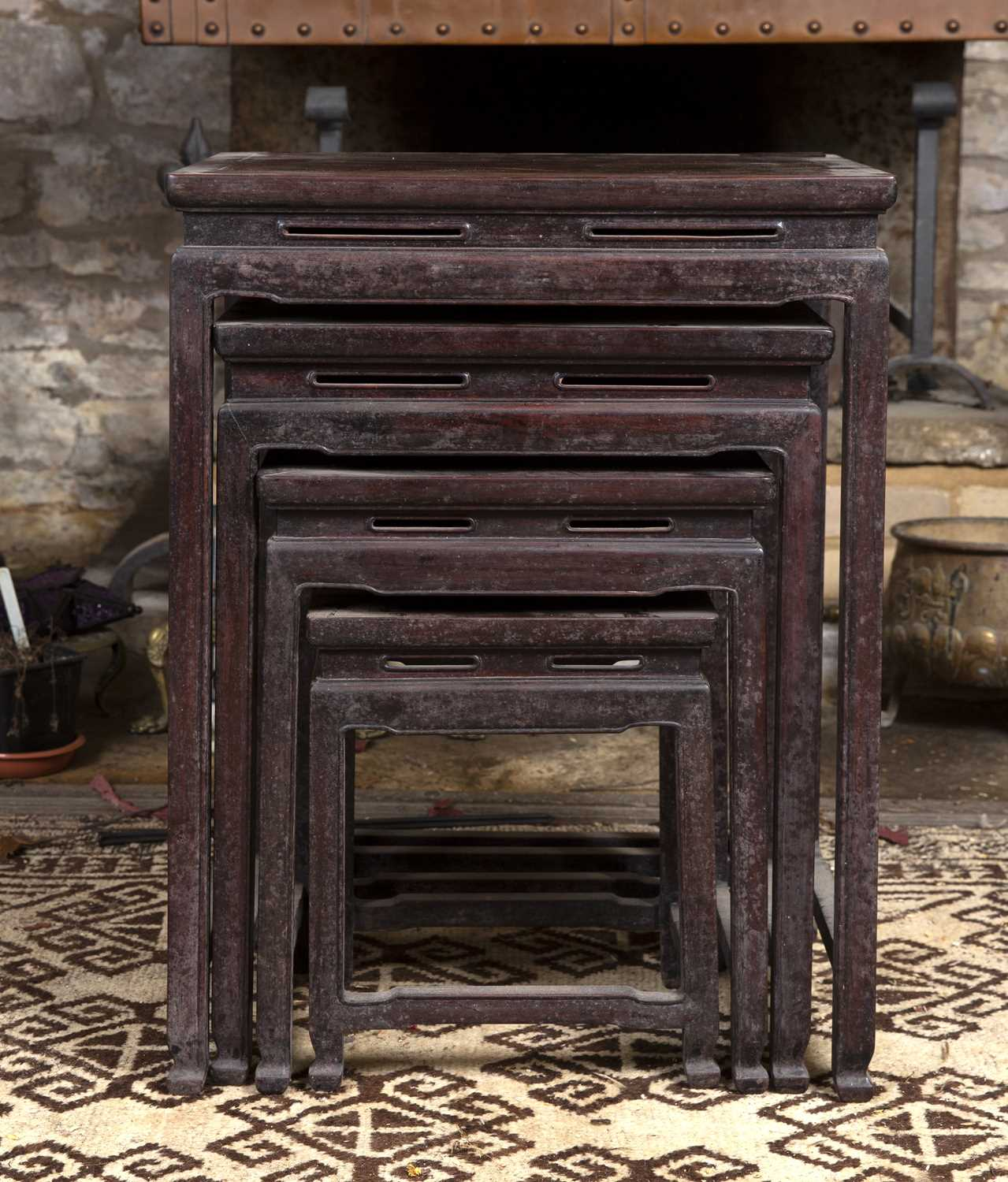 A nest of four graduated Chinese hardwood occasional tables, with pierced friezes, on square legs, - Image 2 of 2