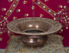 An Ottoman large circular copper spittoon or basin with broad lobed rim, 46cm diameter