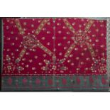 A Pakistan, Sind, finely embroidered wedding shawl fragment with star and florette design on a red