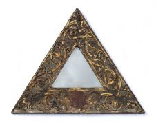 An 18th century continental carved giltwood triangular hanging wall mirror with scrolling acanthus