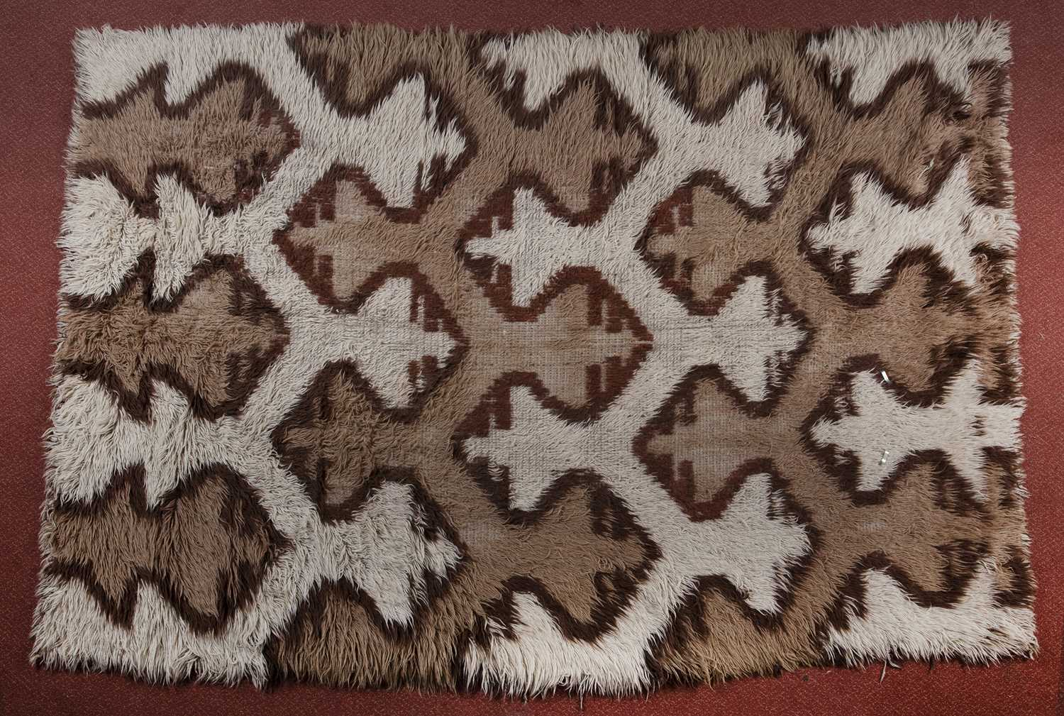 A Turkish shag-pile small carpet, white and brown dyes and stylised 'X' design, 252 x 175cm