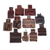A group of eleven Azerbaijan salt bags of varying design and some with tassel ornament