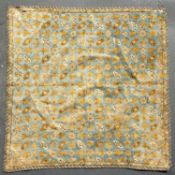 An 18th century Caucasian blue ground embroidered on silk square panel decorated with a design of