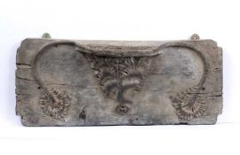 An early English oak Misericord, rectangular with twin carved water lily like leaves and central