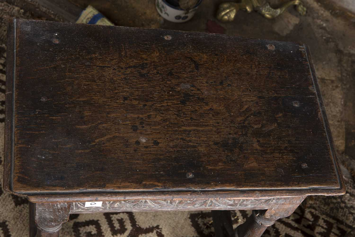 A late 17th/early 18th century oak joint stool, the frieze carved with stylised stretchers, 45. - Image 3 of 3
