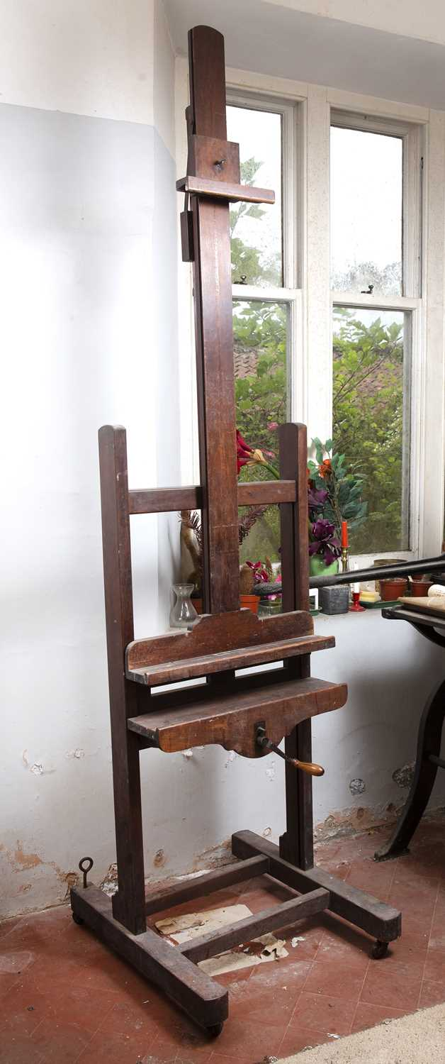 A Victorian mahogany artist's easel, with adjustable column, and shaped base with castors, 66cm