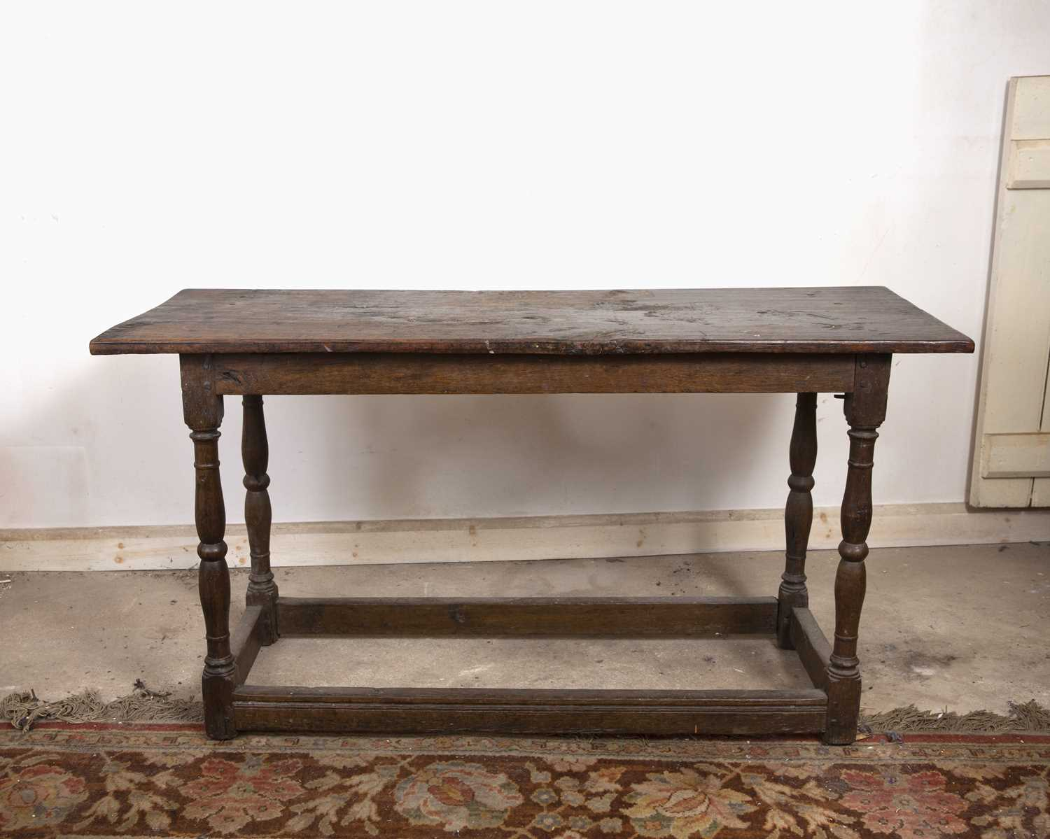 An 18th century oak rectangular side table, on baluster turned legs united by stretchers, 125cm