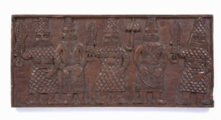 A Benin carved rectangular panel, a central OBA with umbrella and four attendant figures, 60 x 27.