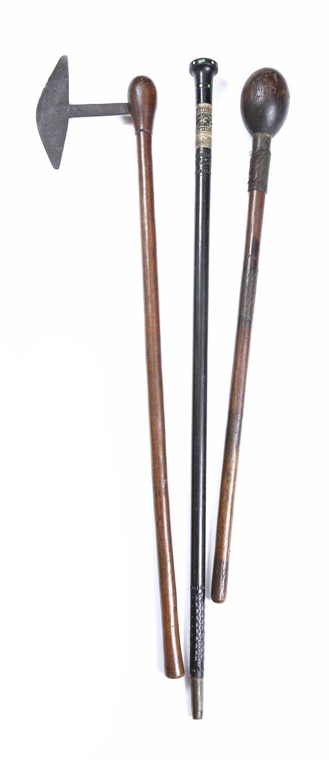 A South African Zulu knobkerrie, carved wood with metal wire grips together with an axe and a - Image 3 of 3