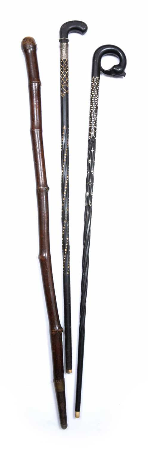 Two old Sri Lankan ebony and ivory inlaid walking sticks and a bamboo stick with brass mounts, - Image 2 of 3