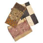 Three African Kuba cloths, raffia cloth skirt decorated with cowrie shells, another with black dye