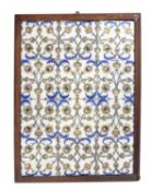 An 18th century European pottery tile panel, the twelve tiles forming a trellis of stylised yellow