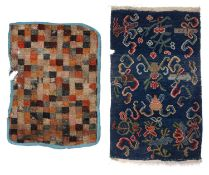 A Tibetan blue ground saddle rug with symbolic ornament, 84 x 50cm; and another with multi-