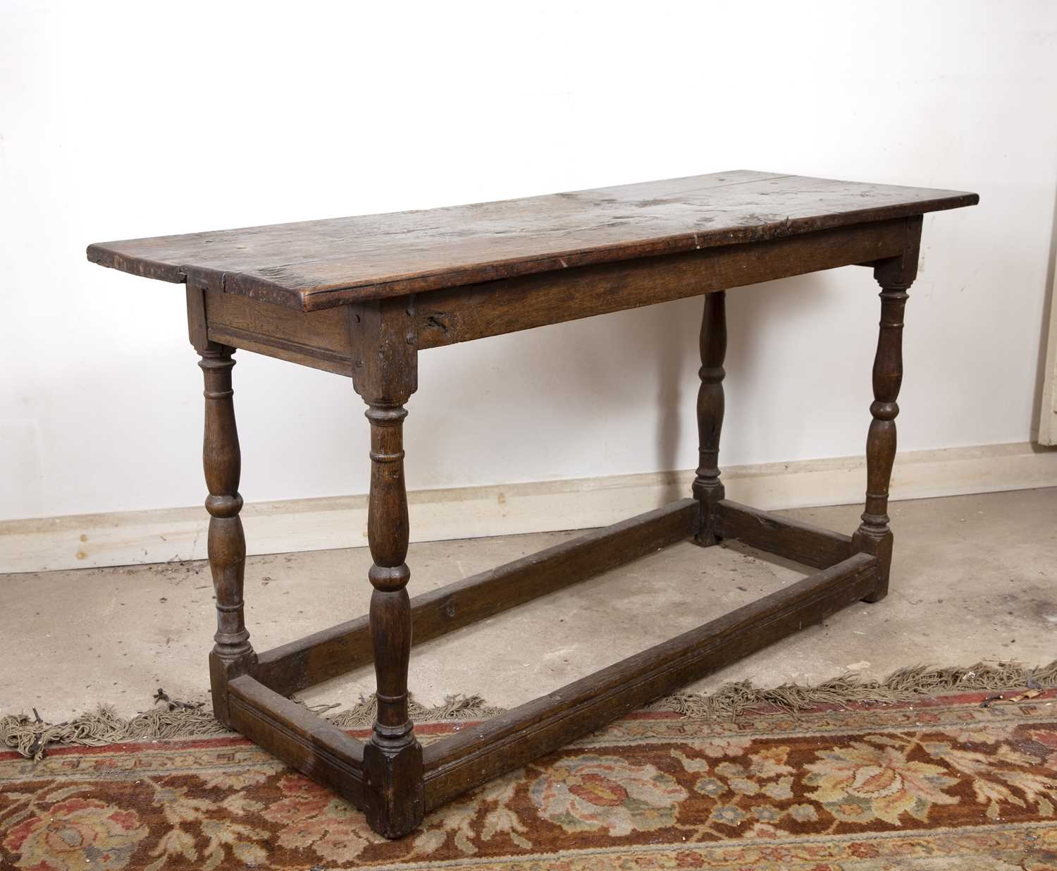 An 18th century oak rectangular side table, on baluster turned legs united by stretchers, 125cm - Image 3 of 4