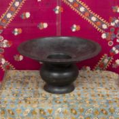A Malay bronze spittoon with broad rim on baluster stem, 32cm diameter