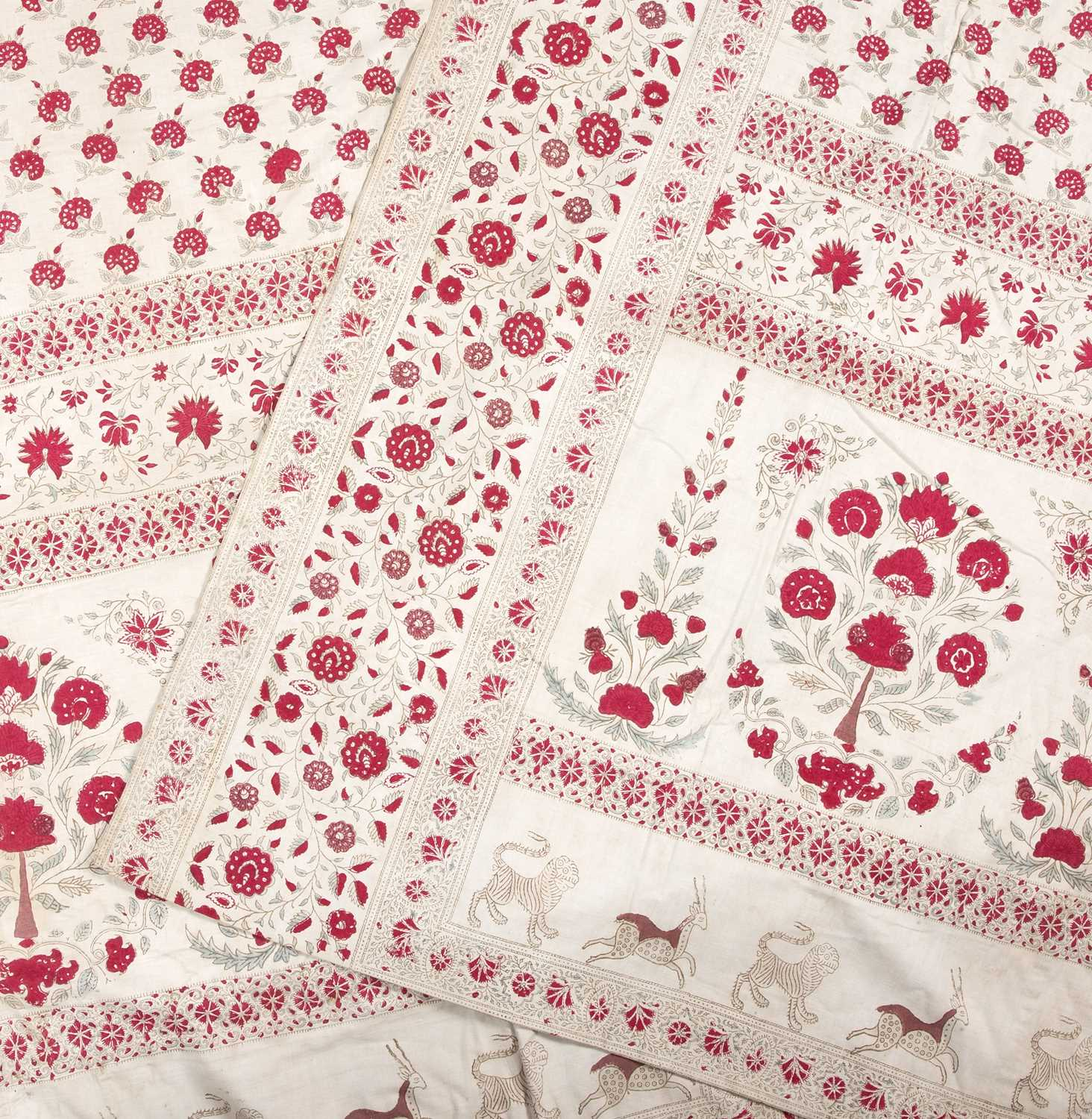A pair of Indian Kalamkari bird and animal wall hangings forming one panel with red flower printed