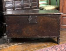 A late 17th century oak plank coffer, on plain stile supports, 97cm