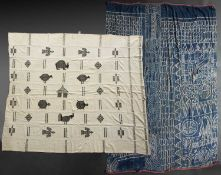 A West African stip woven cotton and wool blanket with stylised animal motifs, 175 x 150cm and a