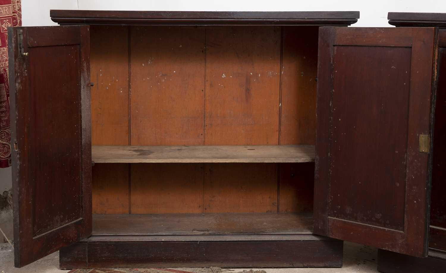 A pair of 19th century mahogany cupboards, each with a pair of panelled doors enclosing shelving, on - Image 4 of 4