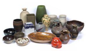 A group of pottery to include a Bretby green glaze vase; a slipware dish; an Italian cream glaze
