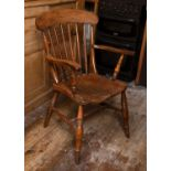 A 19th century beech and elm kitchen armchair with stick back and solid seat, on turned legs with '