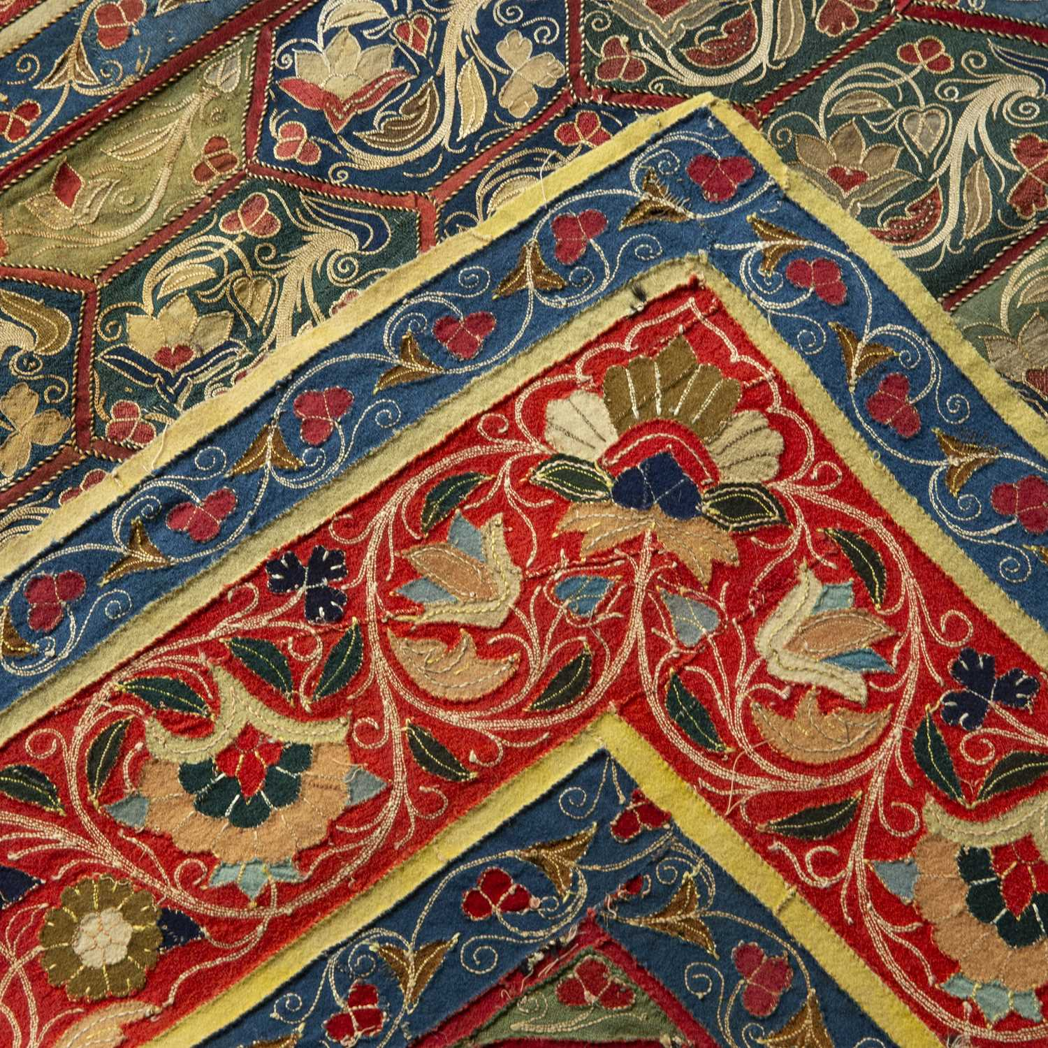 A 19th century Persian rectangular needlework table cover with a colourful repeating geometric and - Image 2 of 2