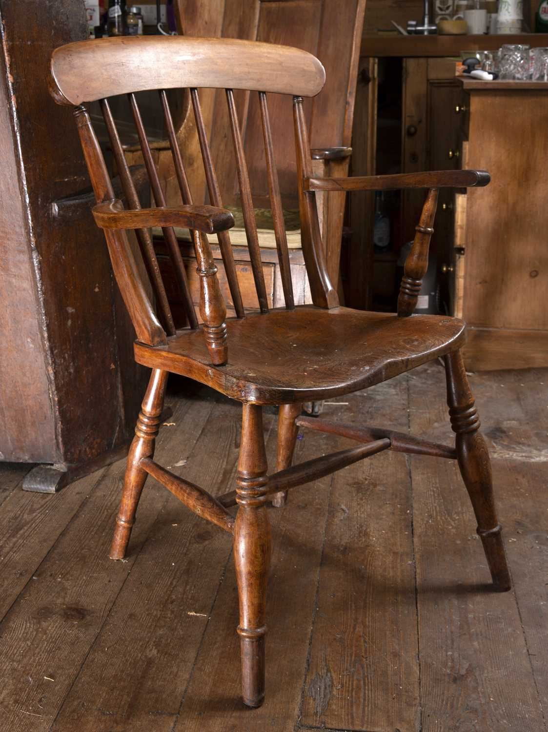 A 19th century beech and elm kitchen armchair with stick back and solid seat, on turned legs with ' - Image 5 of 5