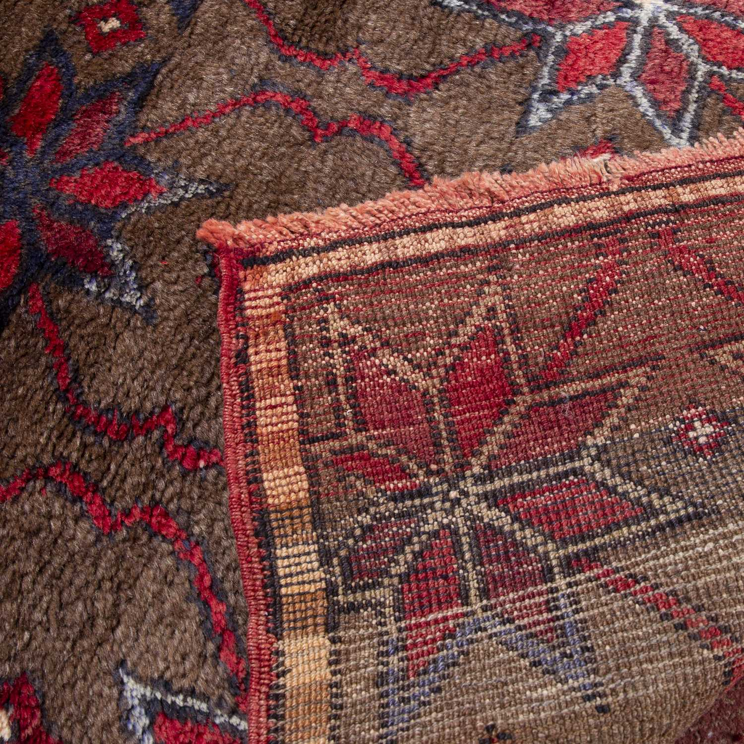 A Turkish Tulu with blue and red star motif on a mid brown ground, 137 x 115cm - Image 2 of 2