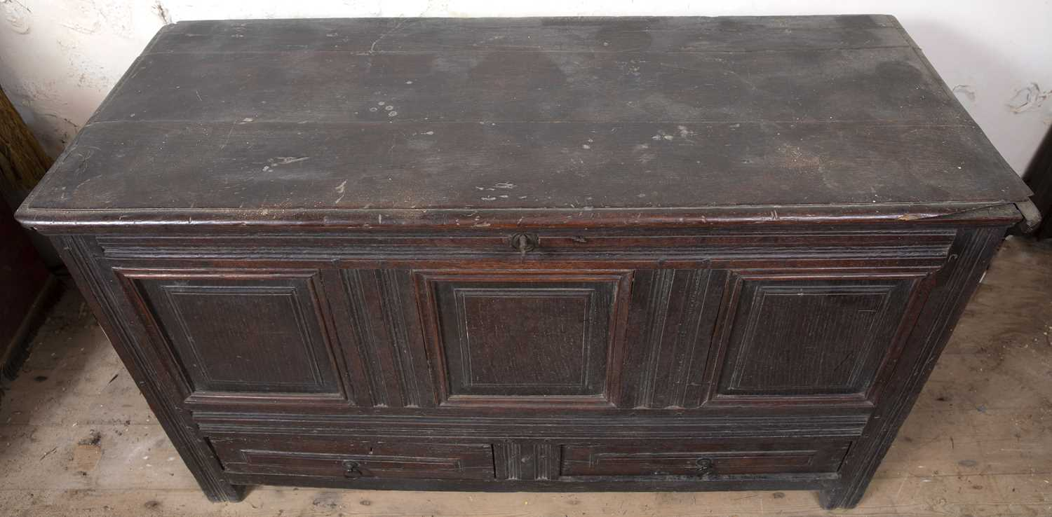 A late 17th Century oak coffer, with triple panelled front above two drawers, on block feet, 124cm - Image 4 of 5
