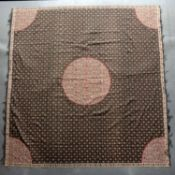 A Moon Shawl, possibly Norwich 19th century, with rows of flowers on a black ground and central
