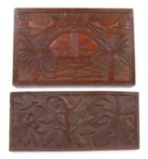 A Benin carved rectangular panel depicting a crown with crossed swords and snake, 56 x 36.5cm; and