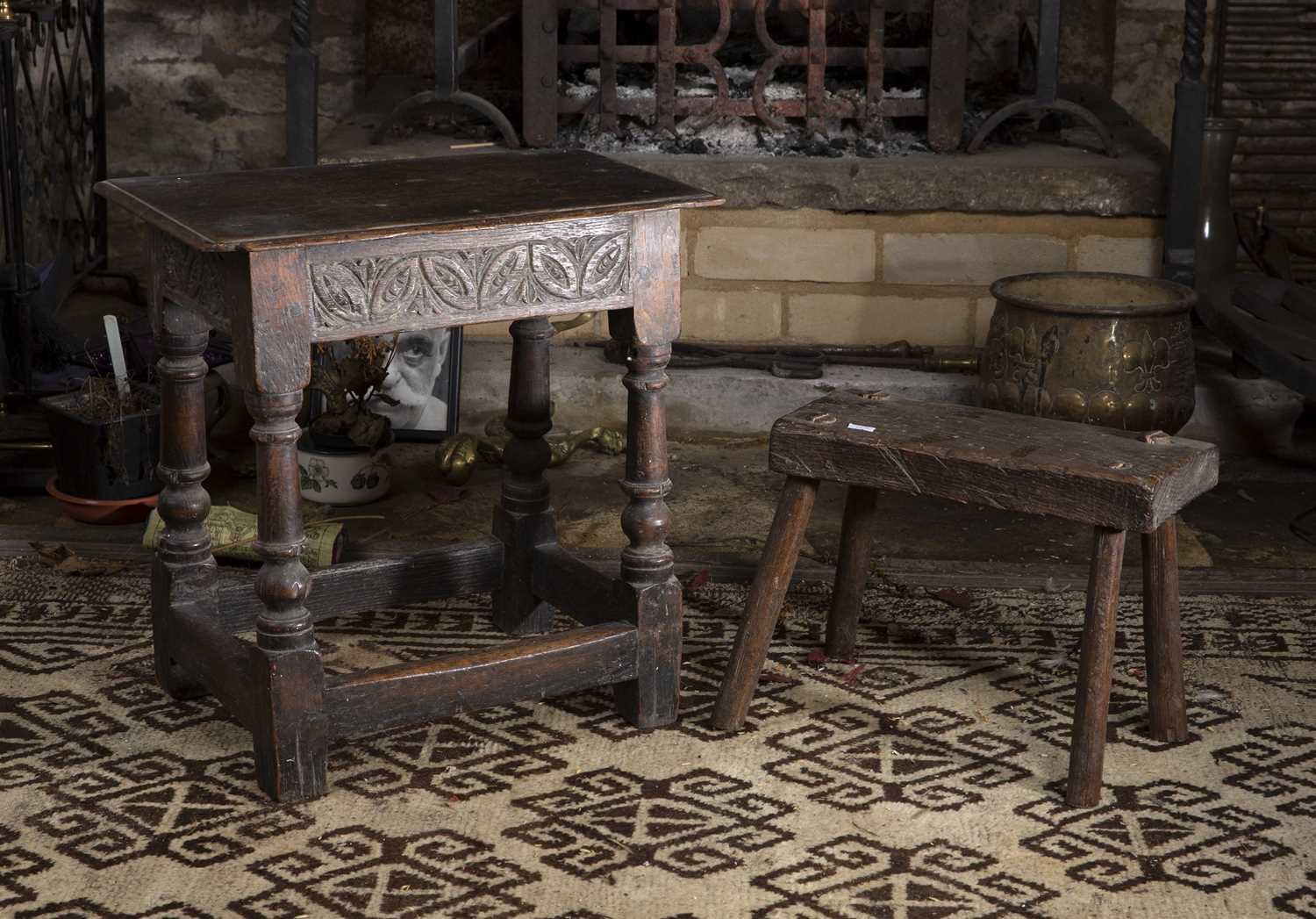 A late 17th/early 18th century oak joint stool, the frieze carved with stylised stretchers, 45.