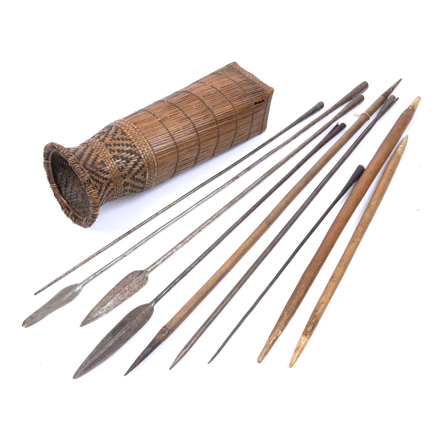 A set of three Masai spears, with iron blades together with a woven basket work Turkana container (