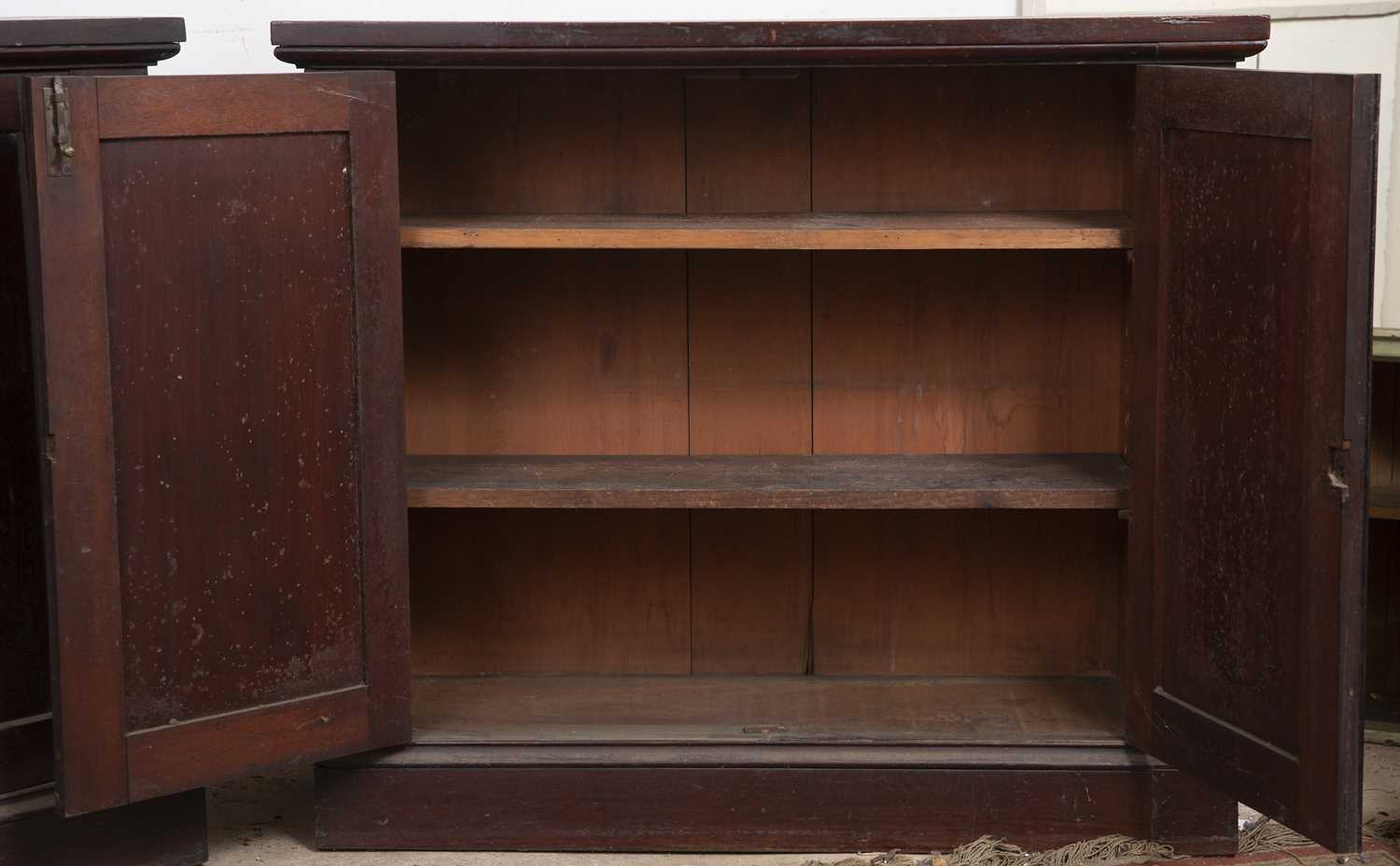 A pair of 19th century mahogany cupboards, each with a pair of panelled doors enclosing shelving, on - Image 3 of 4