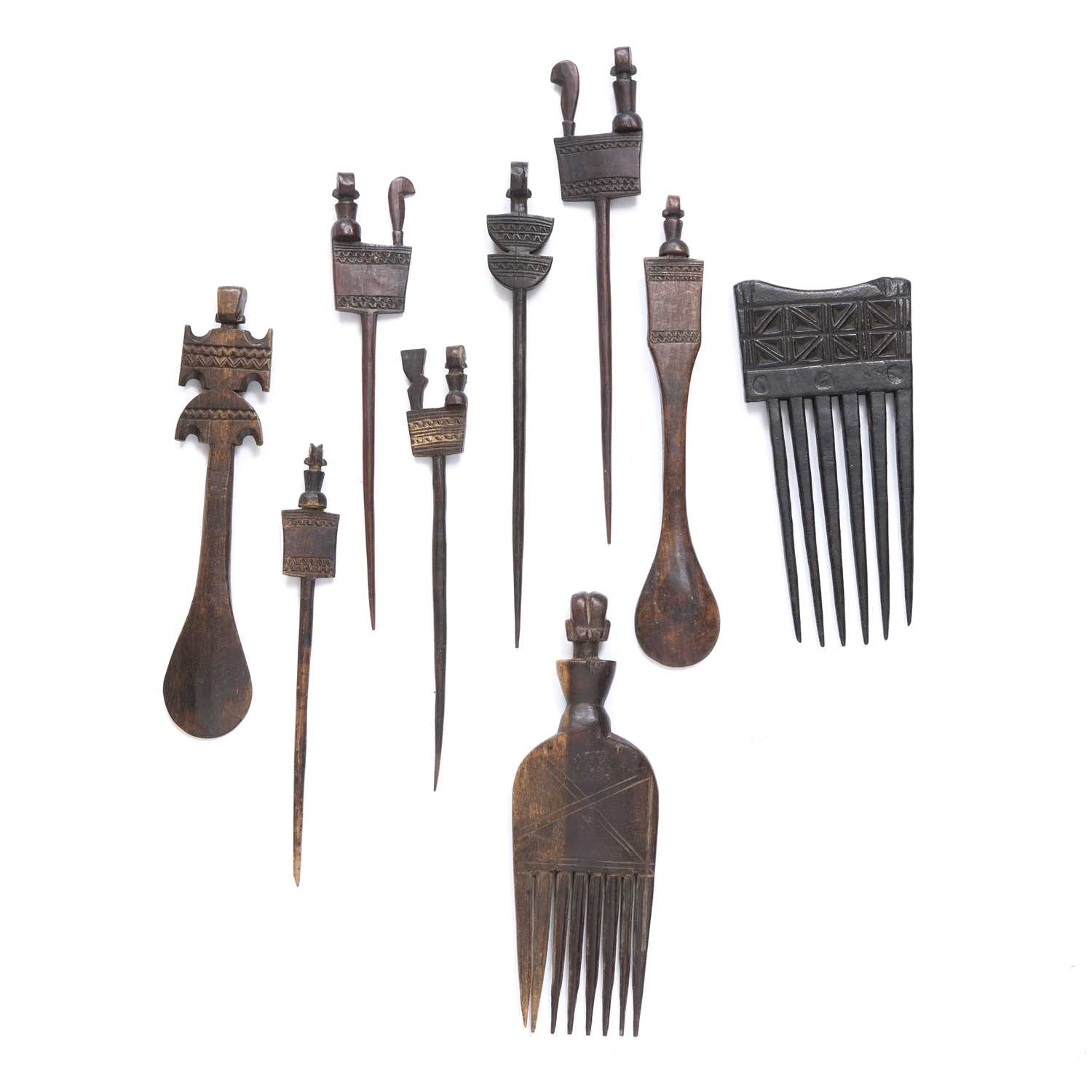 African Hemba hair combs and spoons, nine in total all carved wood, some with carved with figures to - Image 2 of 2