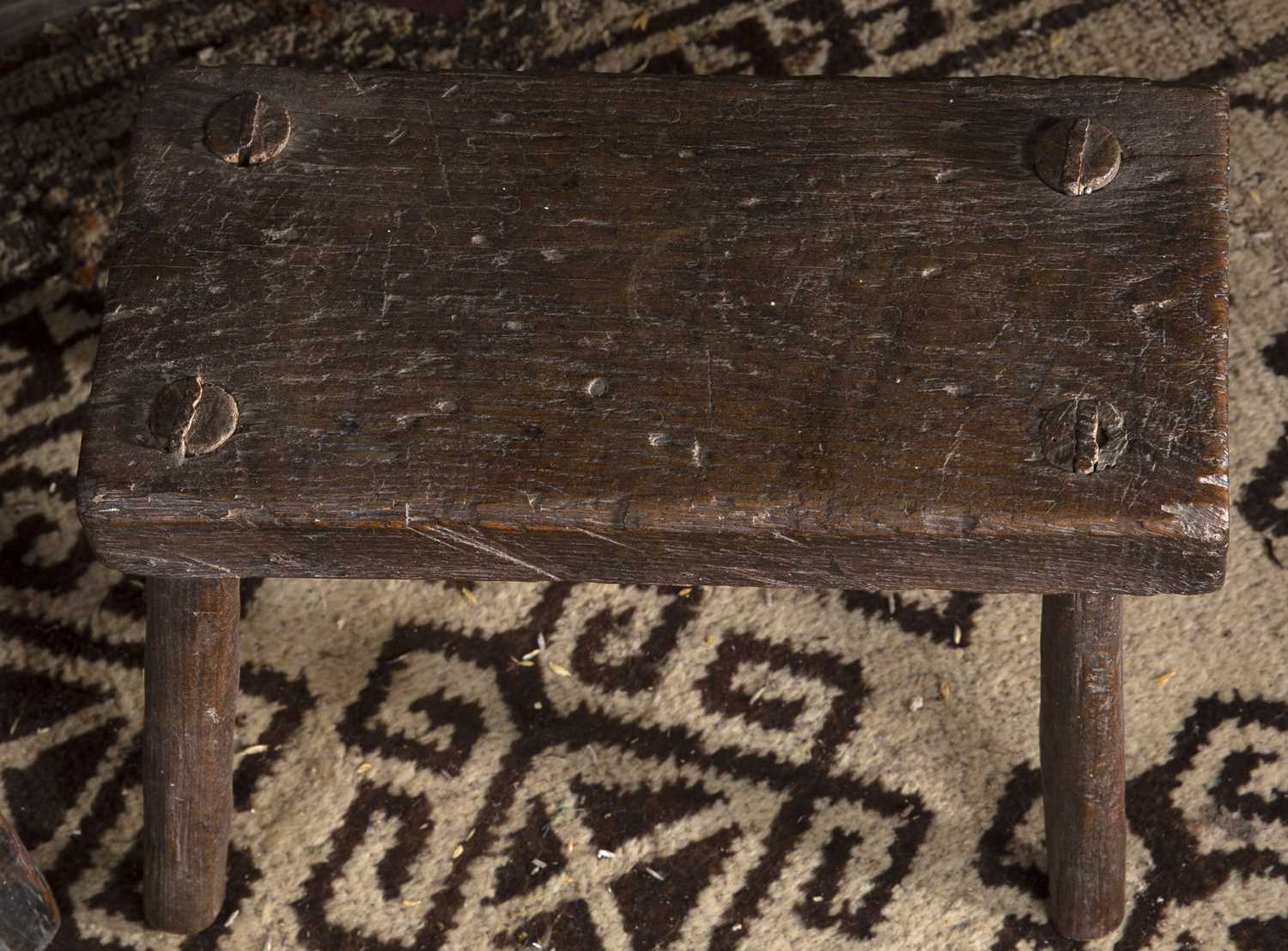 A late 17th/early 18th century oak joint stool, the frieze carved with stylised stretchers, 45. - Image 2 of 3