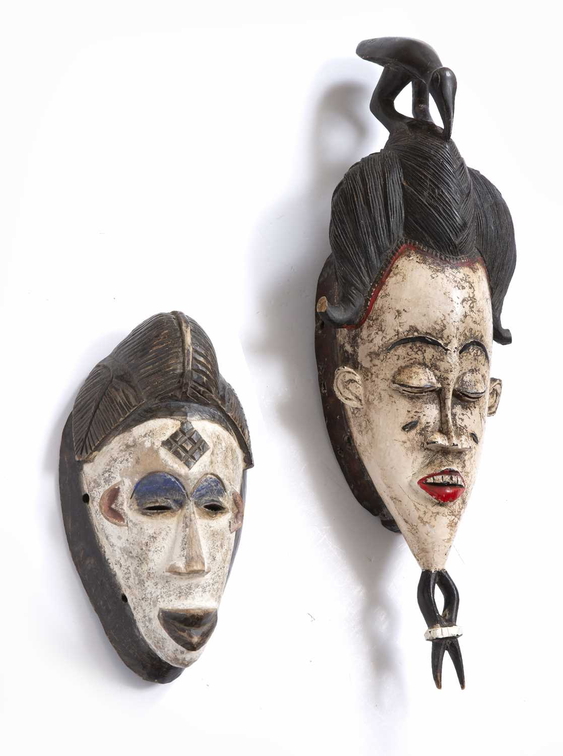 A Baule mask, Ivory Coast, carved wood with high incised coiffure topped by a bird with white and - Image 3 of 4