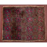 A Turkish Tulu with blue and red star motif on a mid brown ground, 137 x 115cm