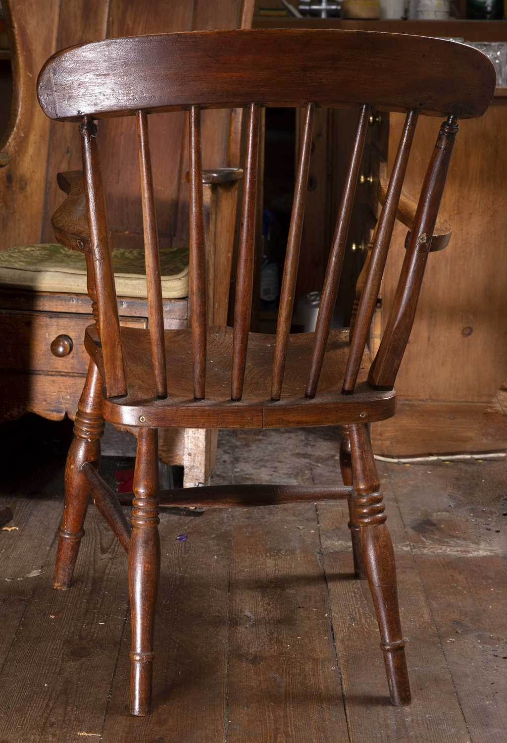 A 19th century beech and elm kitchen armchair with stick back and solid seat, on turned legs with ' - Image 4 of 5