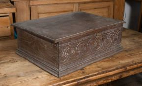 A late 17th century oak bible box, the front with stylised carved decoration, 66cm wide