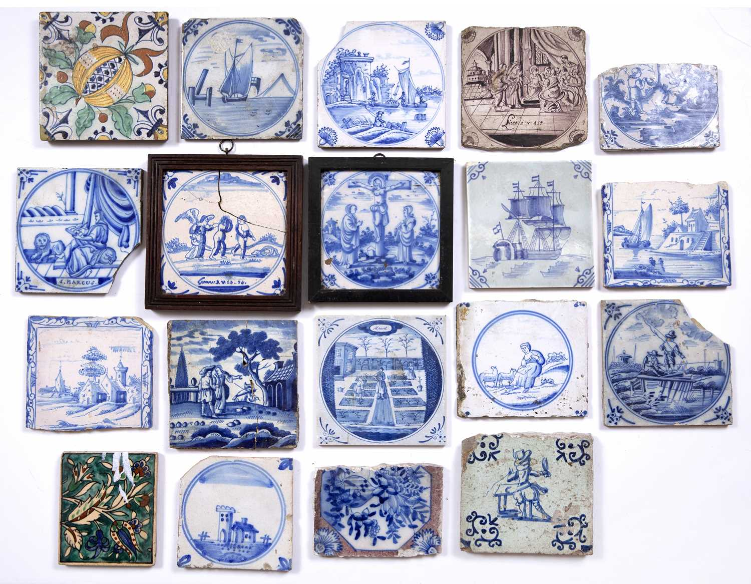A group of nineteen 17th/19th century Delft and other tiles and tile fragments, mainly blue and