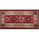 A Serbian Pirot Kelim with a colourful design of hooked medallions, 167 x 84cm
