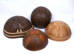 A group of four Fulani (Nigeria) wooden calabashes with collection labels dated 1970's, 43/29cm