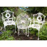 A Victorian white painted wirework garden chair; and a pair of white painted aluminium garden chairs