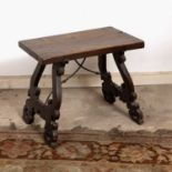 An 18th century Spanish walnut rectangular low table, of shaped scrolling trestle end supports