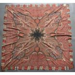 A 19th century Kashmiri shawl, the central black radiating medallion in a red field of scrolls